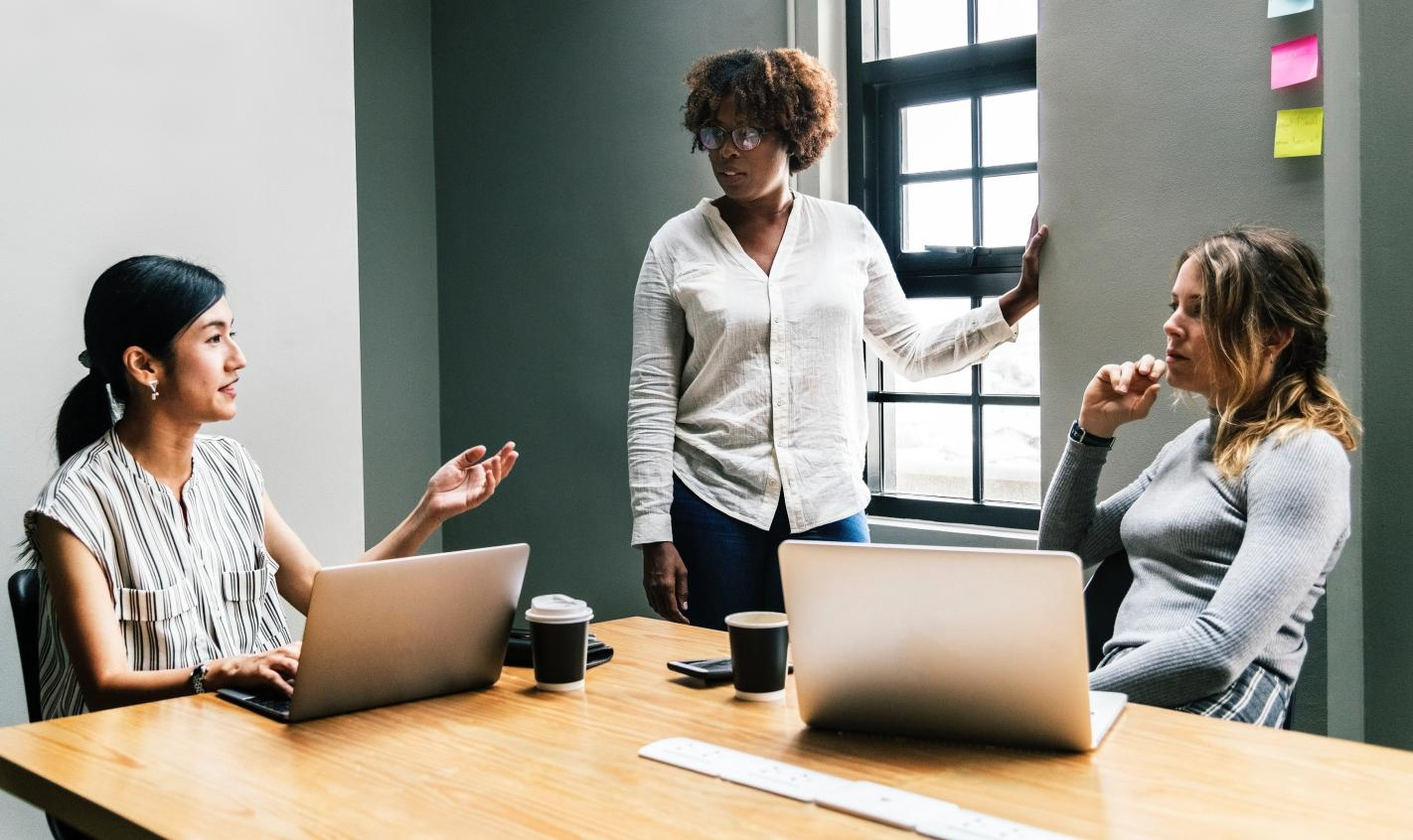 Women leaders discuss in office space